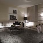 Ambiente de living room con sofás en piel de Fendi Casa