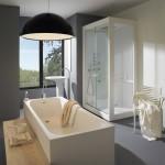 Baño con cabina de ducha y mobiliario de Kos