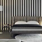 La serie Tufty de Patricia Urquiola también incluye camas de cabecero acolchado