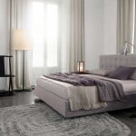 Dormitorio con cama doble de Poliform