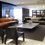 Living-room con sofás modulares en piel de Poliform