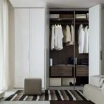 Puertas plegables de armario con gola en laca blanca