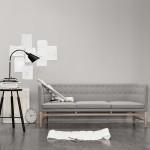 Sofá de diseño escandinavo Mayor con flexo y taburete de And Tradition