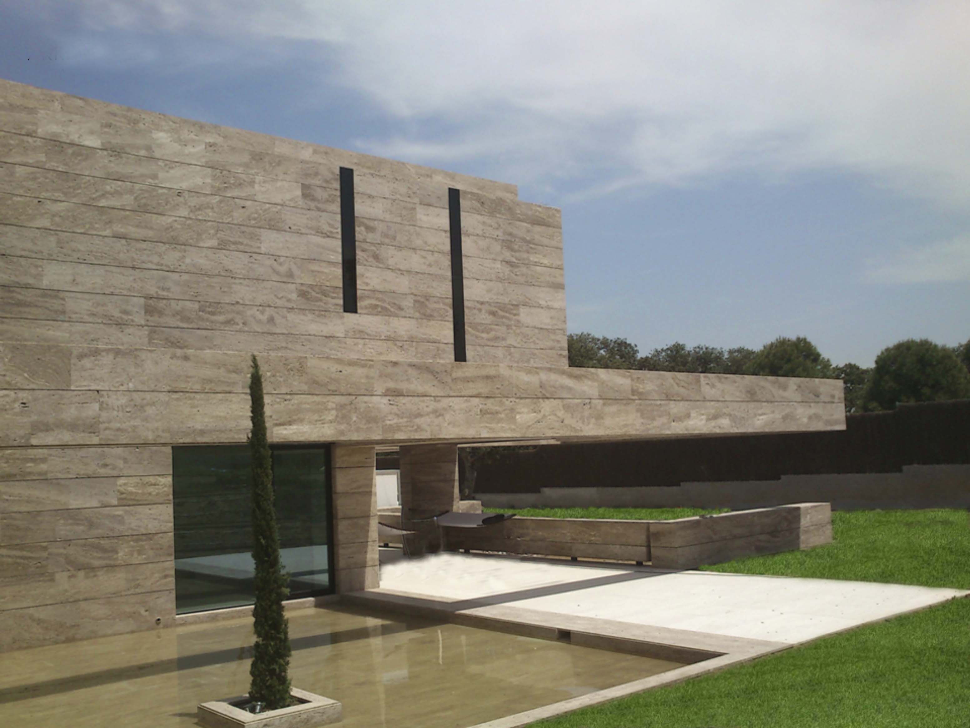 Piedra natural gunni trentino for Piedra natural para fachadas precio